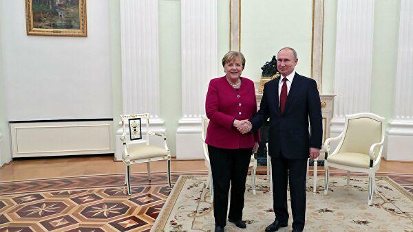 Путин назвал встречу с Меркель полезной и содержательной