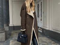 Перниль Тейсбек в длинной дубленке, которая идеально сочетается с любой одеждой